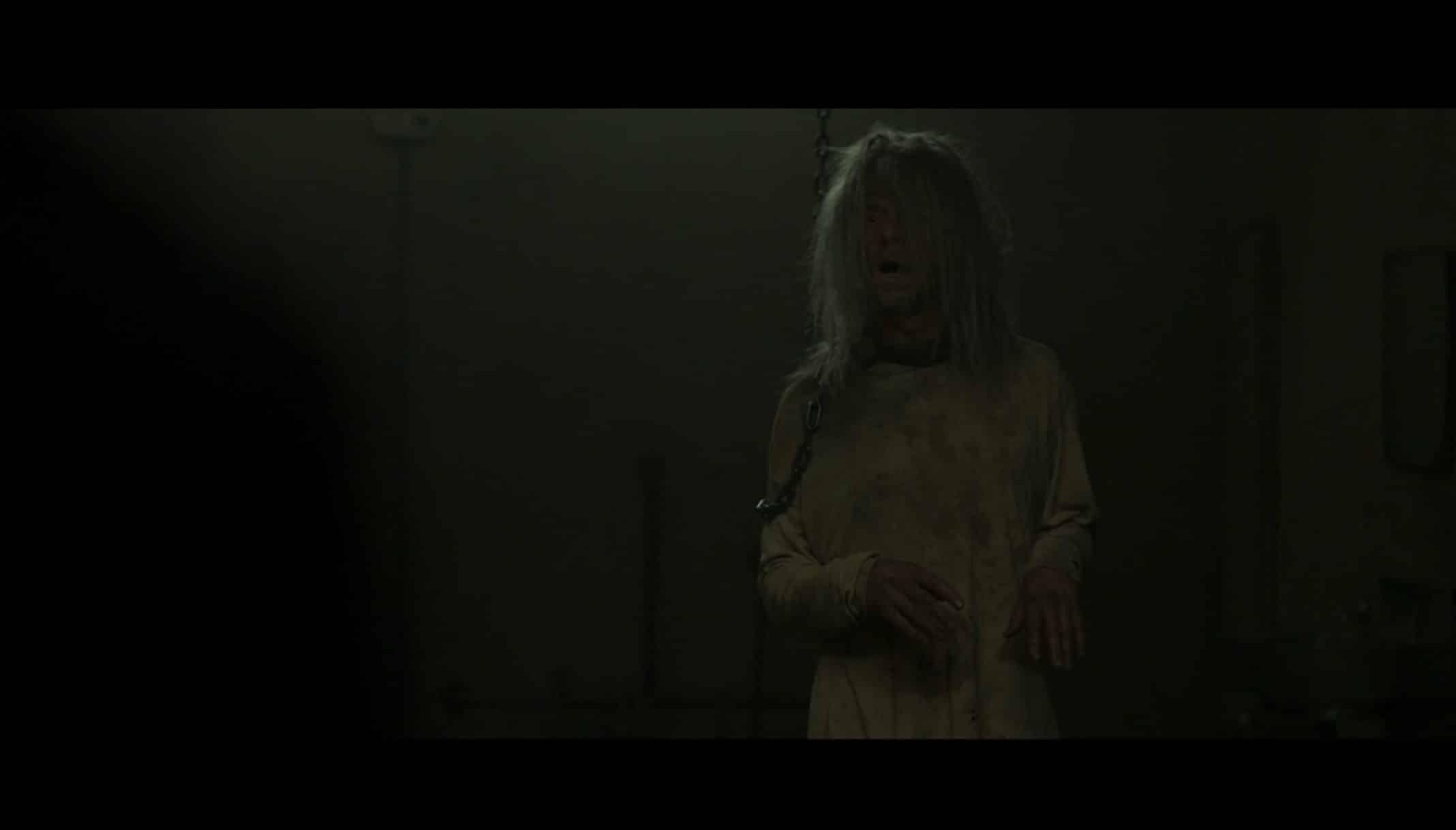 Morgan (Simon Pegg) in a dark room looking disheveled.