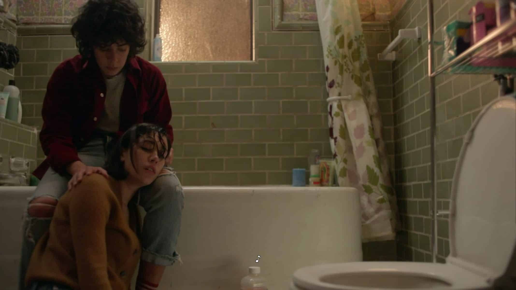 Emma in the bathroom, with Nico, dealing with being sick.