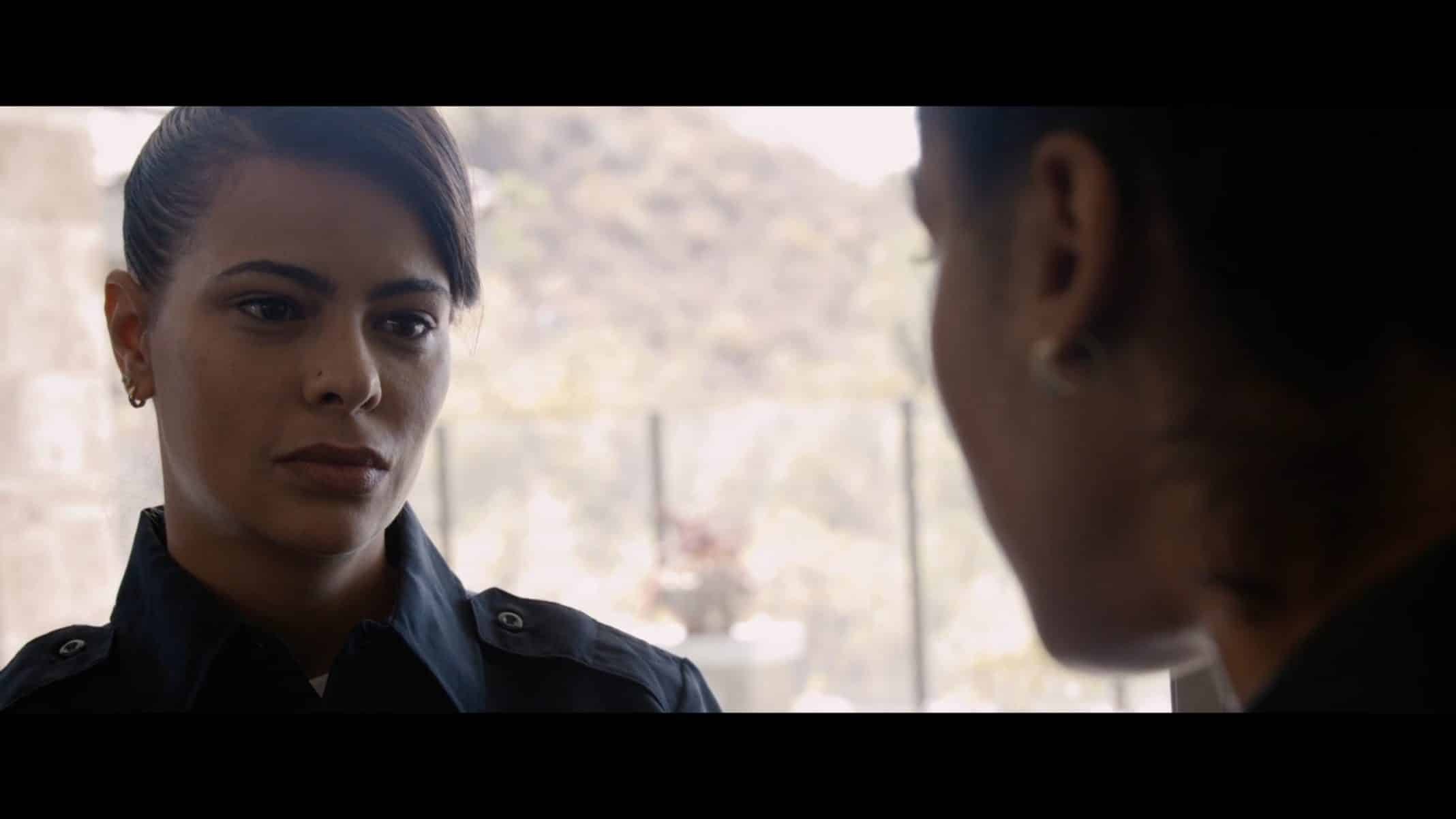 Officer Lopez talking to Erica.