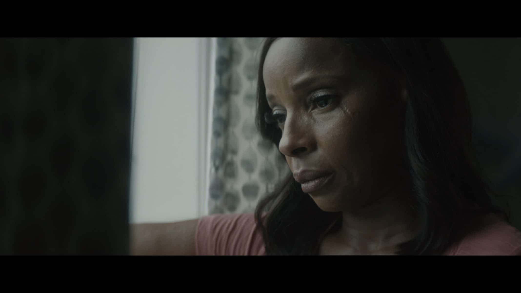 Officer Renee Lomito-Smith (Mary J. Blige) looking out the window.