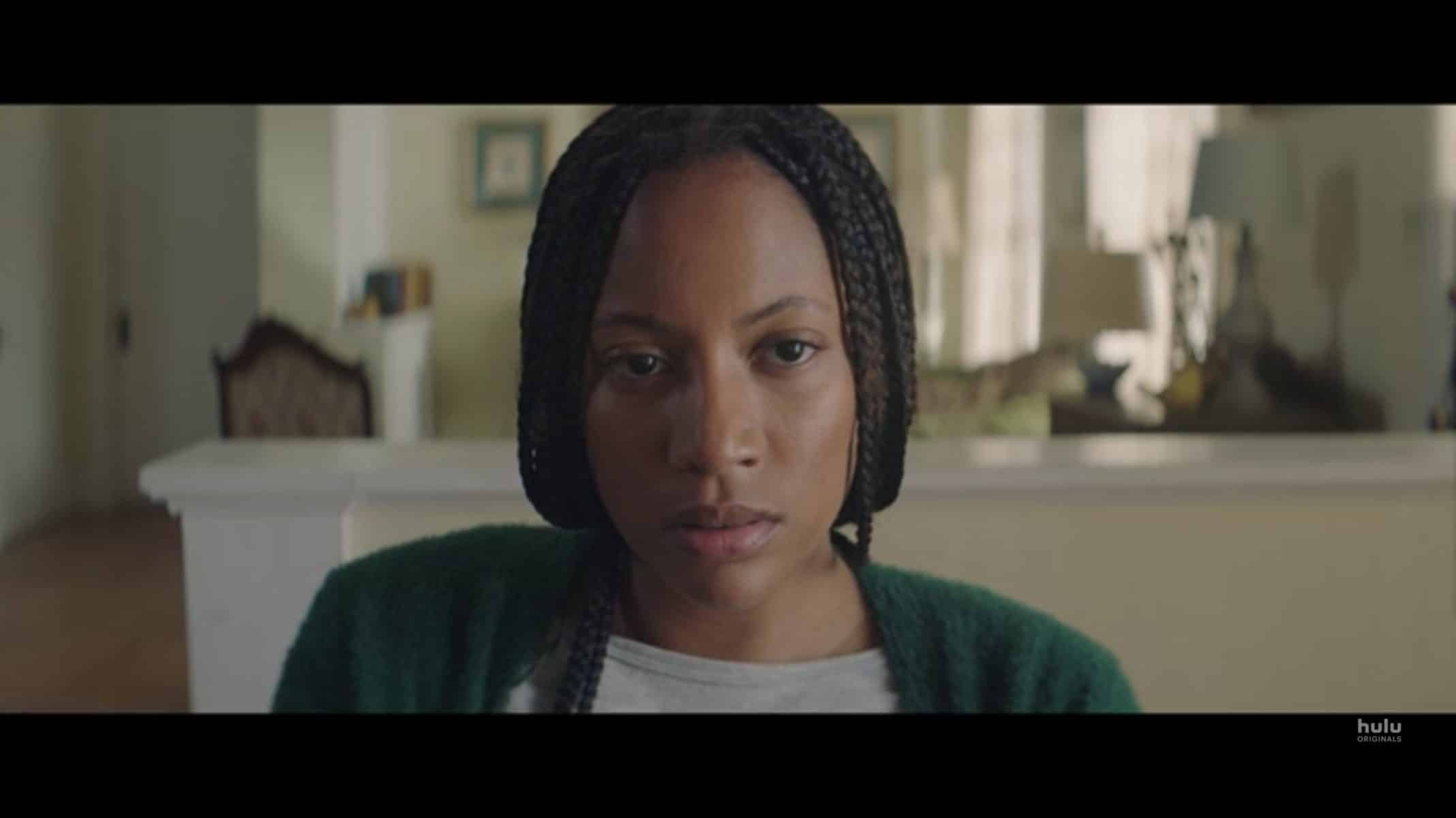 Valerie (Natalie Paul) at Jenny's dining table.