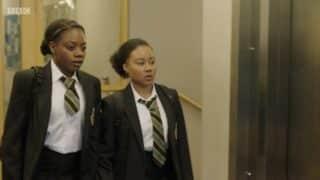 Arabella (Danielle Vitalis) and Terry (Lauren-Joy Williams) walking together.