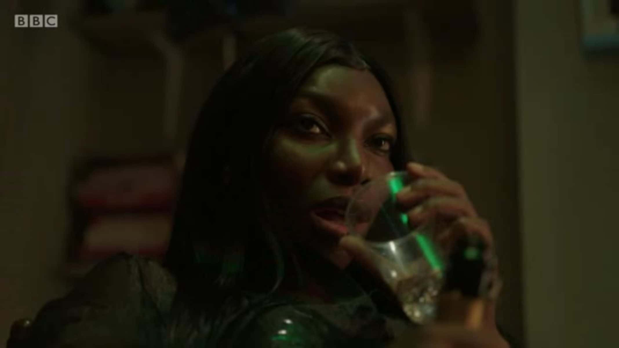 Arabella (Michaela Coel) taking a drink of water - I May Destroy You