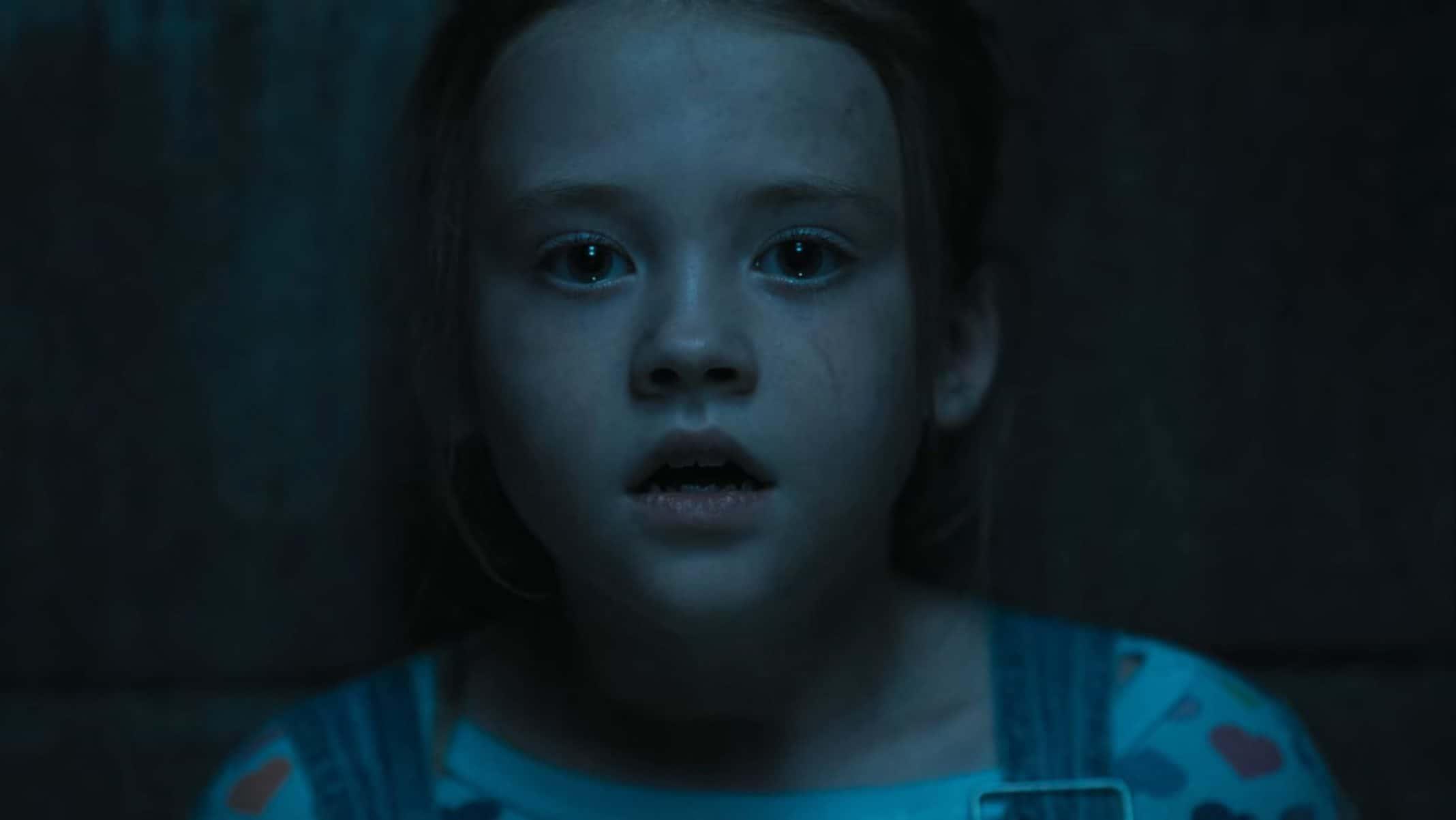 Becca (Kate Moyer) in the basement.