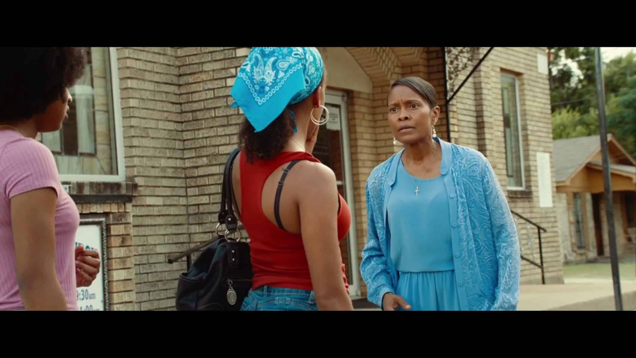 Charlotte (Lori Hayes) talking to Turquoise outside of church.