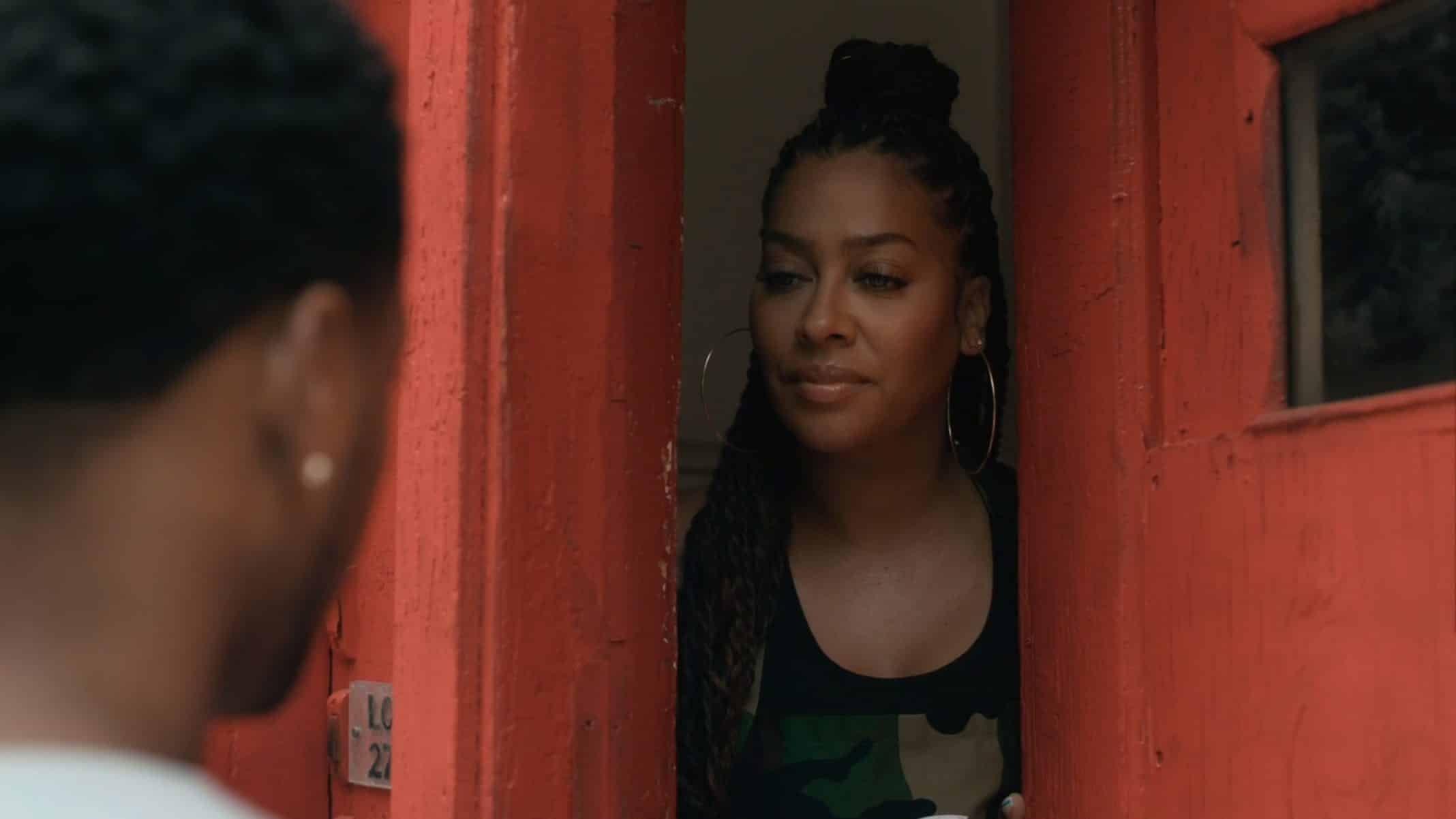 Dominique (Lala Anthony) talking to Emmett at her doorway | The Chi Season 3 Episode 2 Brewfurd