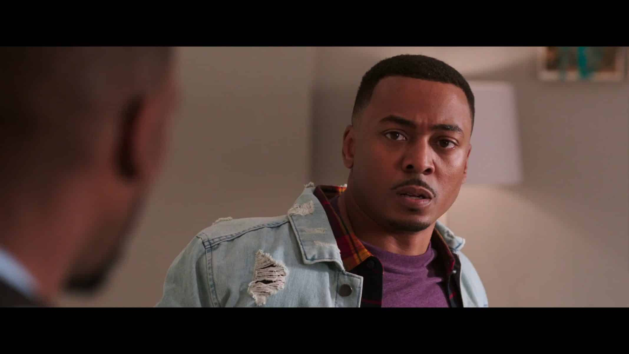 Eddie (Ronreaco Lee) with a slightly shocked expression.