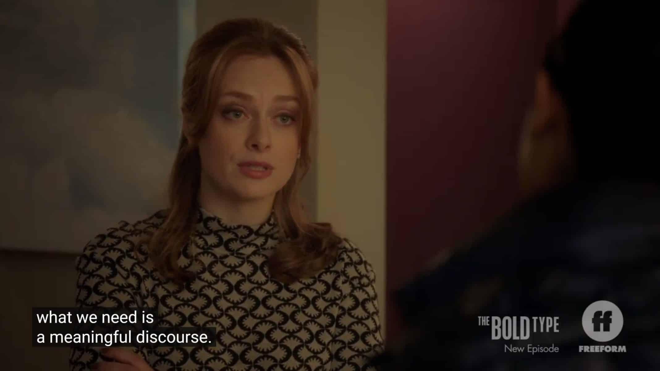 Eva talking to Kat after saving her job.