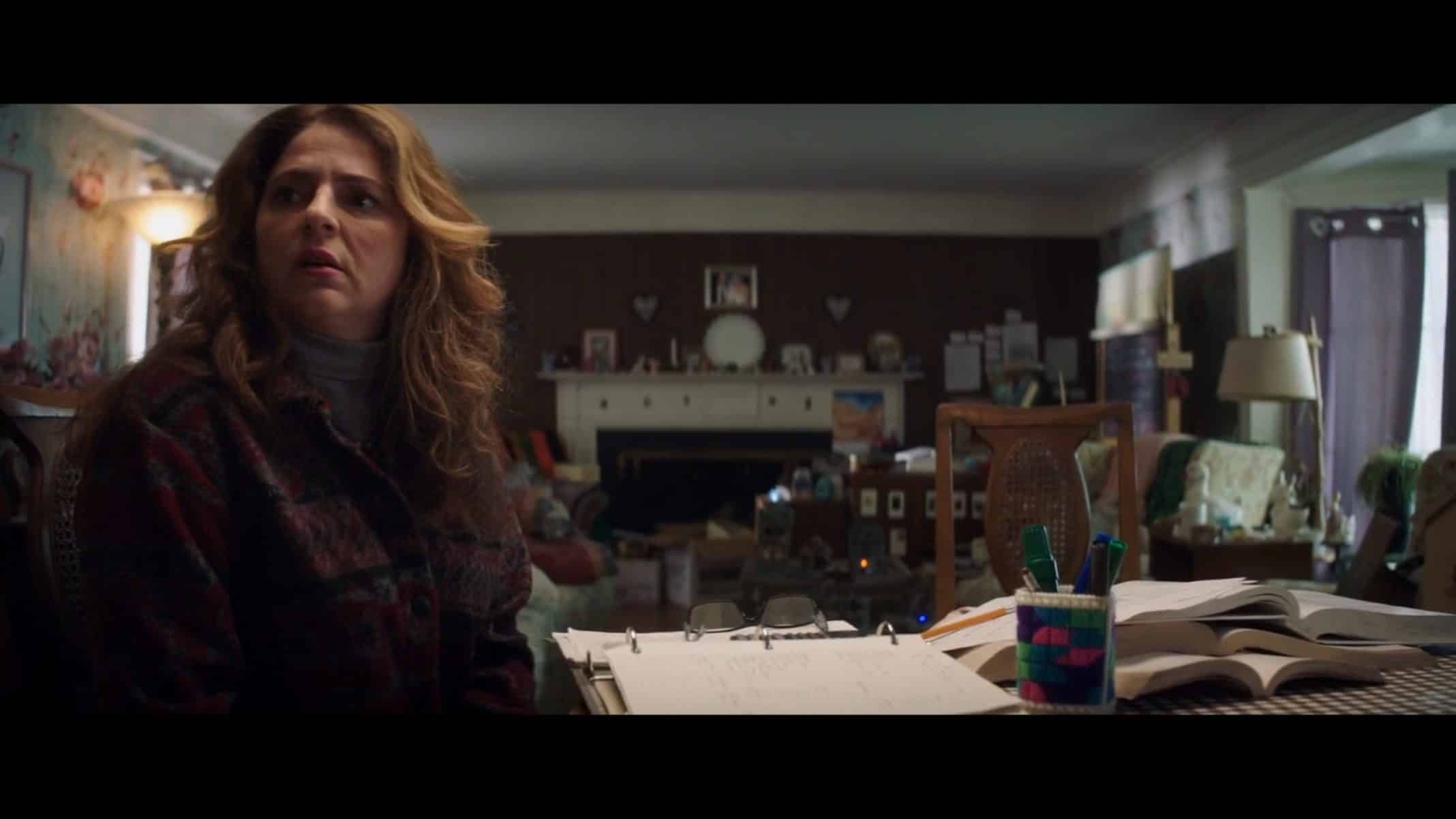 "Jan (Annie Mumolo) looking towards something in ""Looks That Kill."""