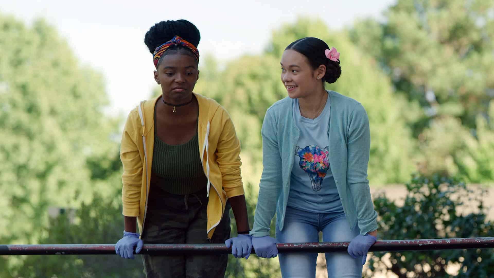Lulu (Ja'ness Tate) and Gabby (Gabriella Pastore) about to jump into a dumpster.