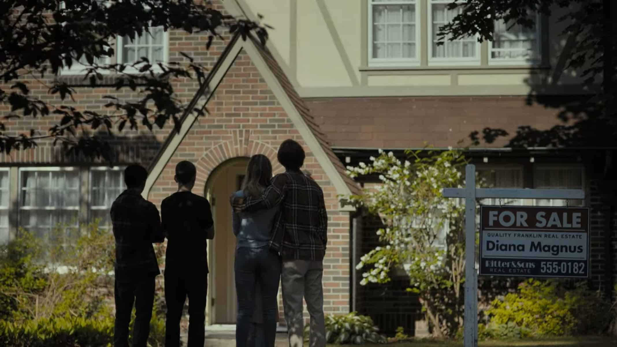 The lead cast, and Matt's friend, in front of their now on sale home.