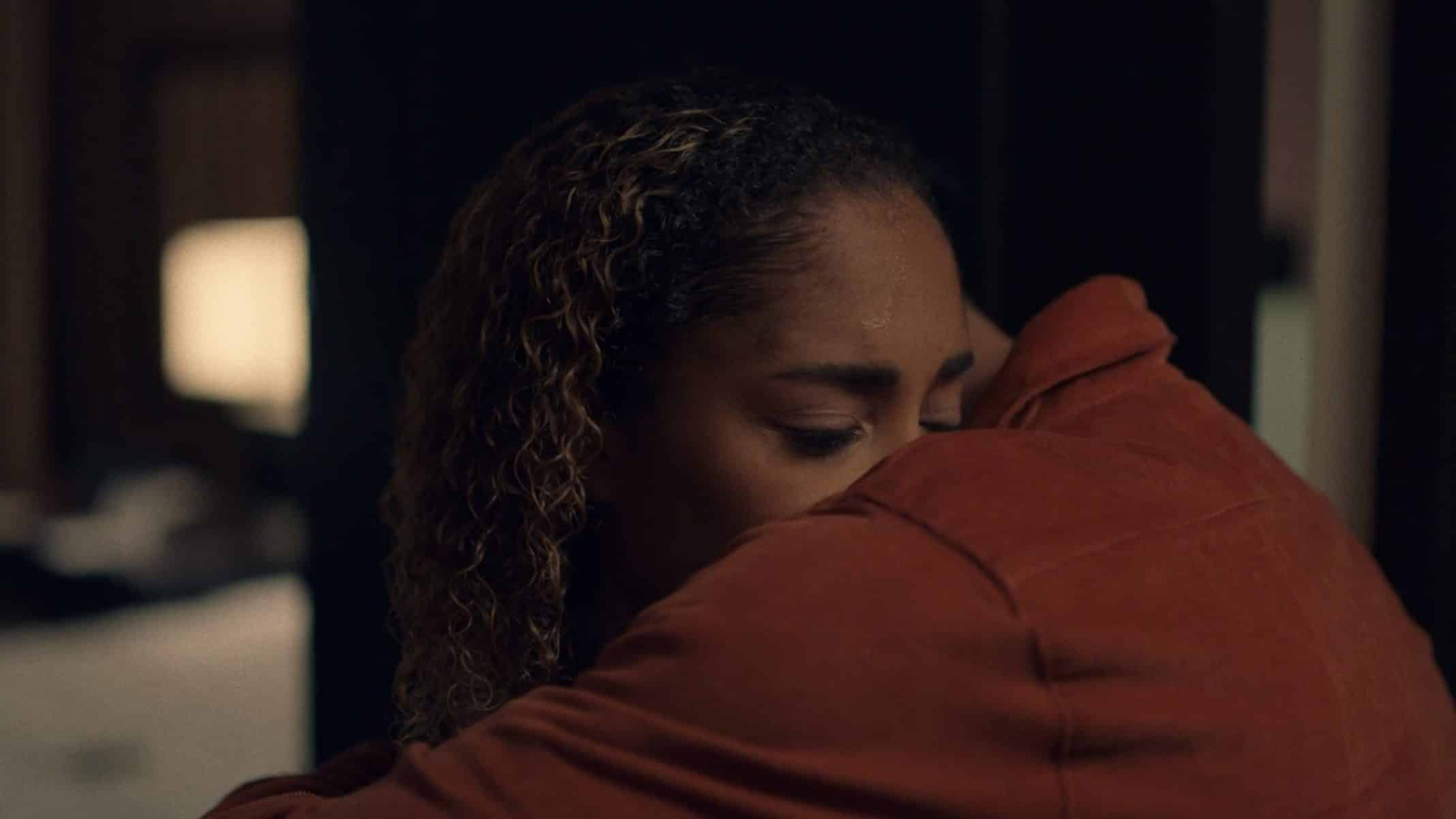 Tiffany being embraced by Derek after apologizing profusely.