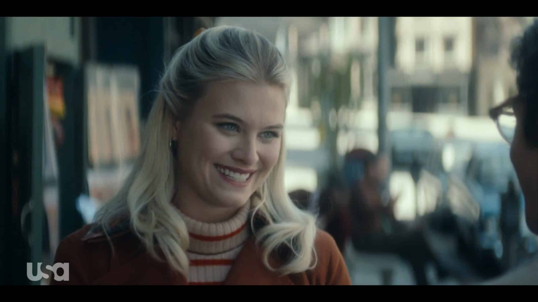Young Betty (Tiera Dyck-Skovbye) smiling on a date.