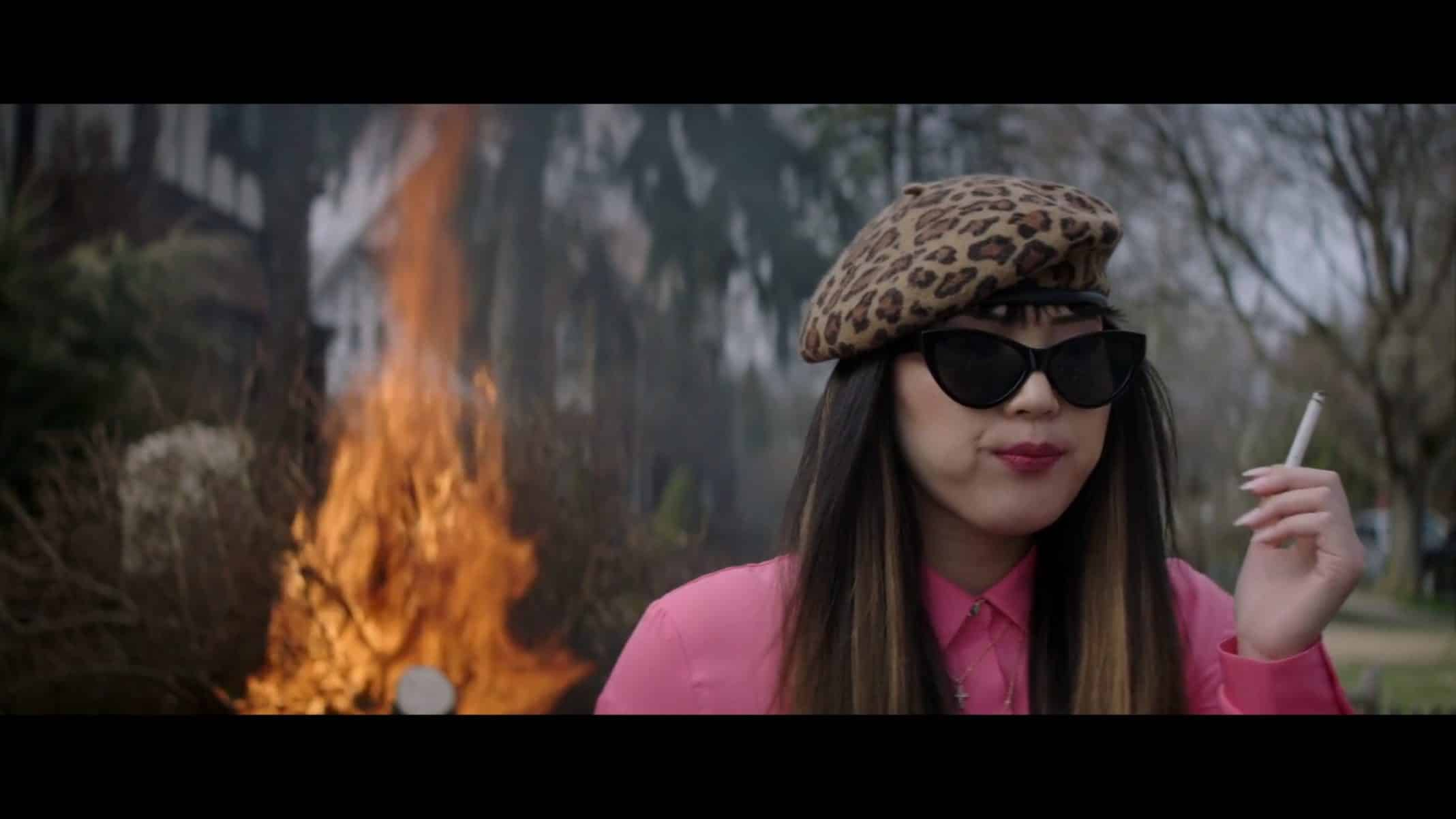 "Yu Shen (Monique Kim) smoking and unbothered in ""Looks That Kill."""