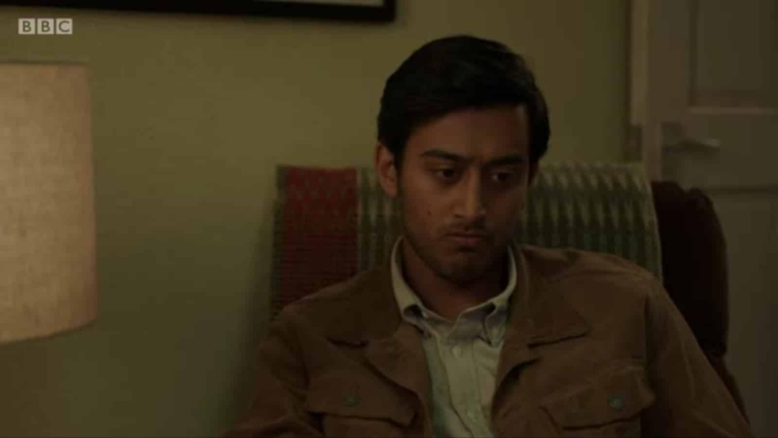 Zain (Karan Gill) sitting, and contemplating something.
