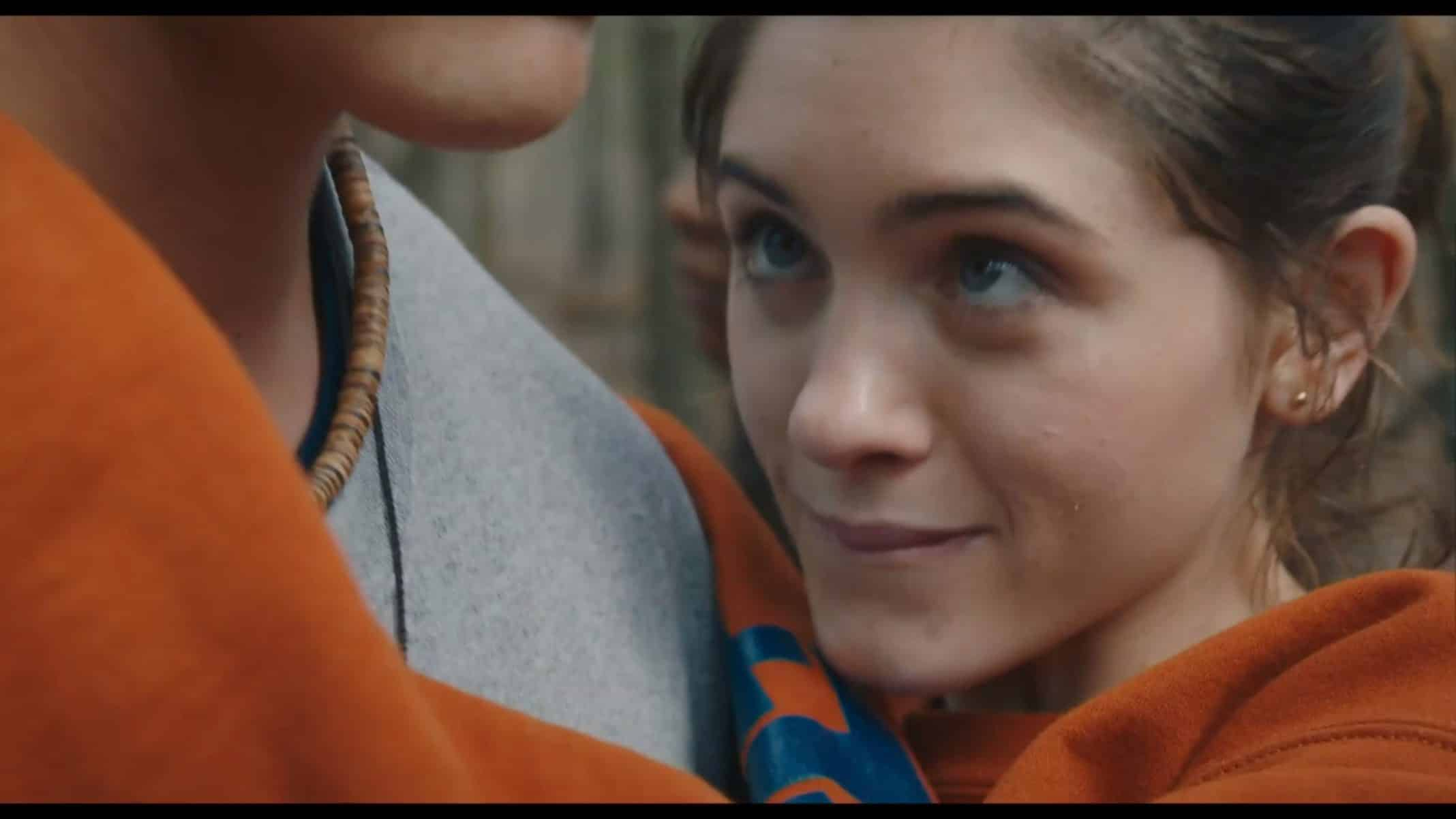 Alice (Natalia Dyer) smiling while in Chris' arms.