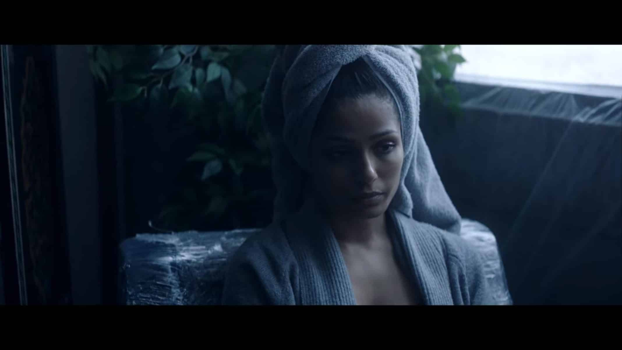 Eva (Frieda Pinto) after taking a shower and prepping to e tested.