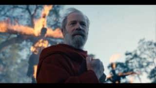 Father Calden (Peter Mullan) as he has people burned