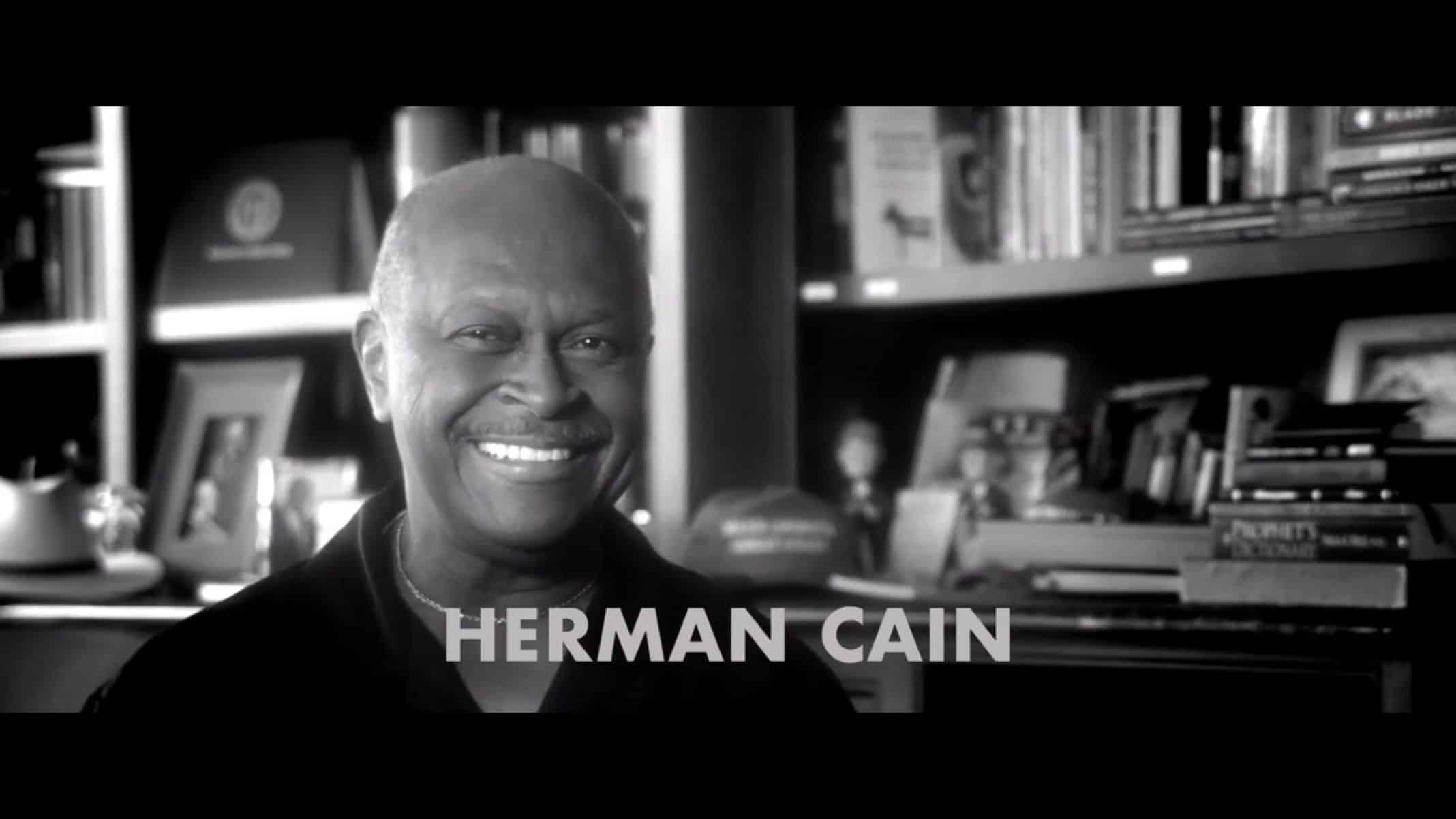 Herman Cain smiling
