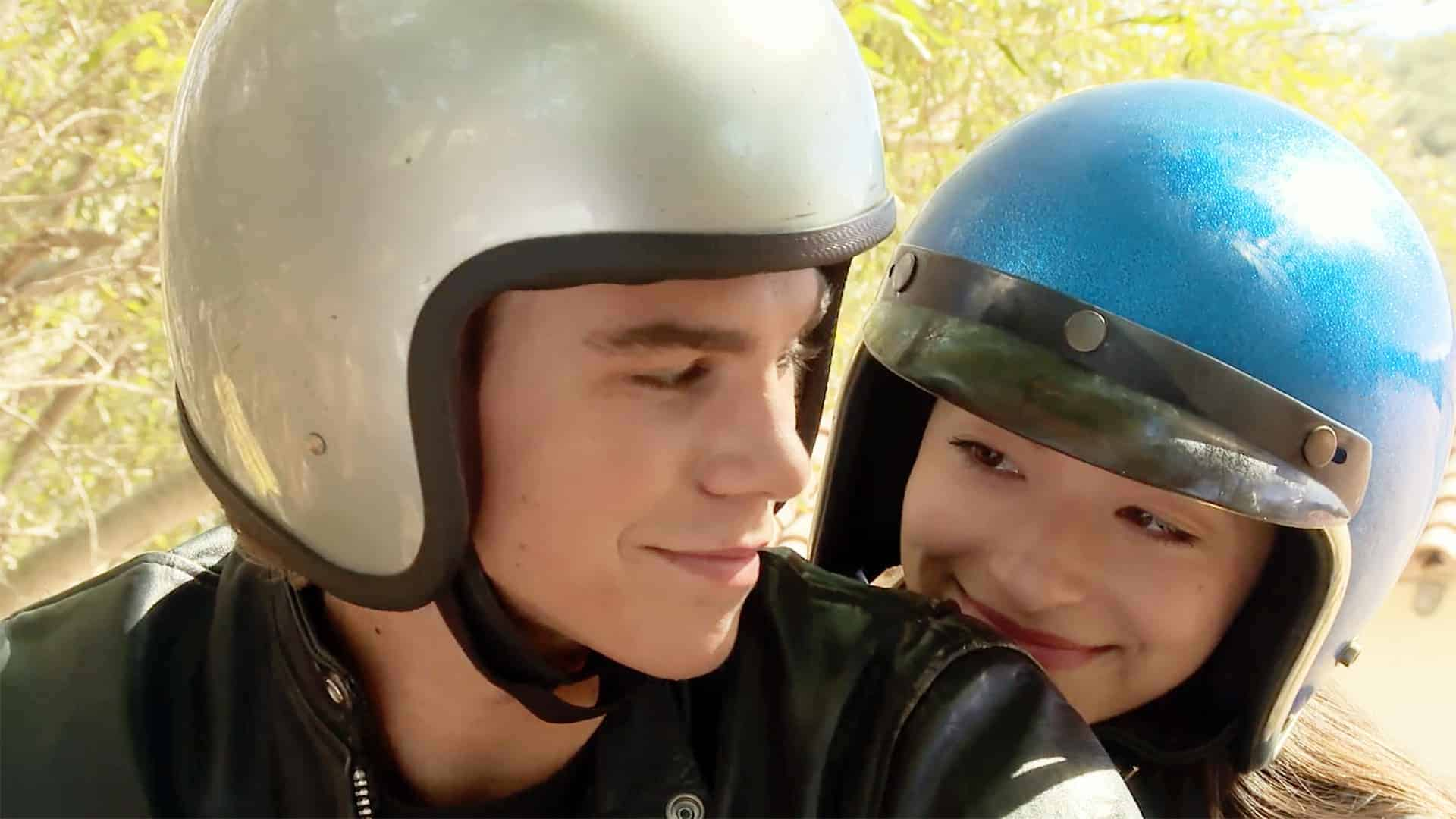 Liza (Mikey Madison) and Brett (Sean H. Scully) on a motorcycle together.