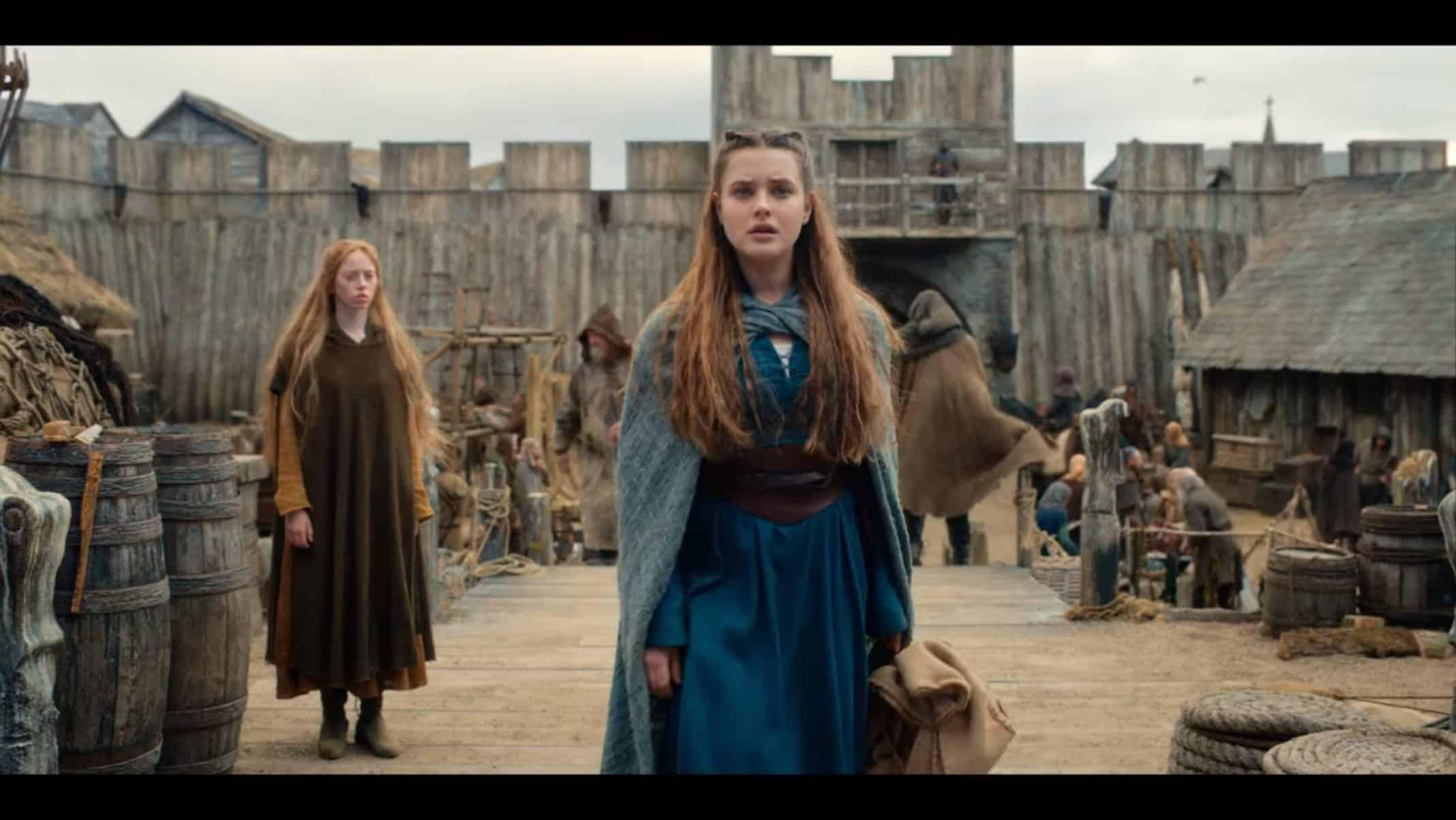 Nimue (Katherine Langford) entering a port town.