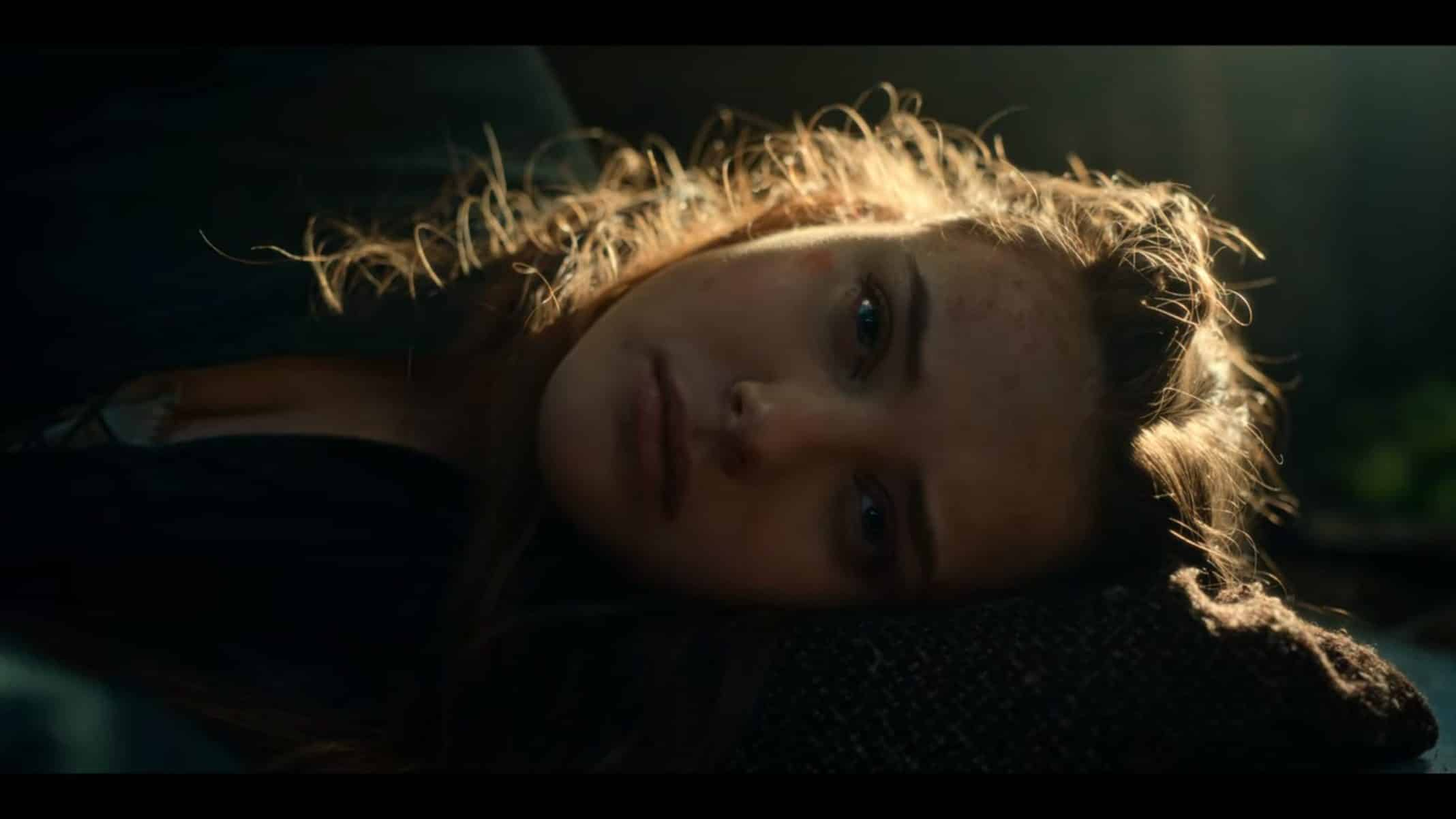 Nimue (Katherine Langford) waking up.