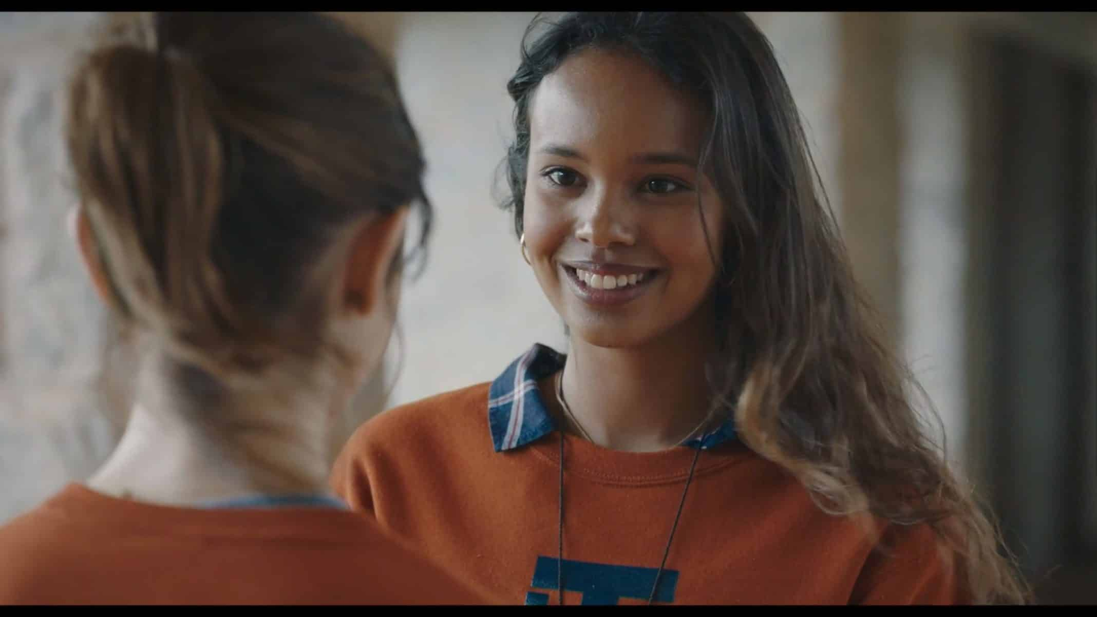 Nina (Alisha Boe) smiling and being shady.