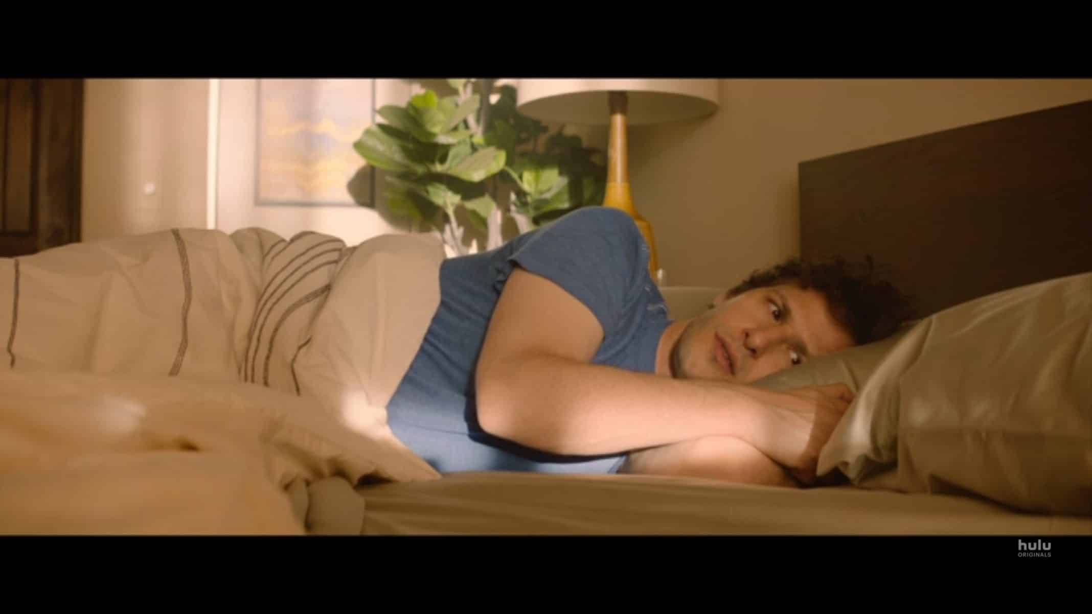 Nyles (Andy Samberg) waking up from a time loop.
