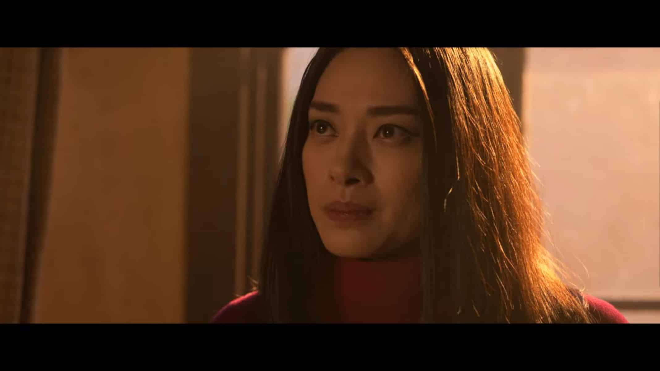 Quynh (Van Veronica Ngo) talking to Booker in his room.