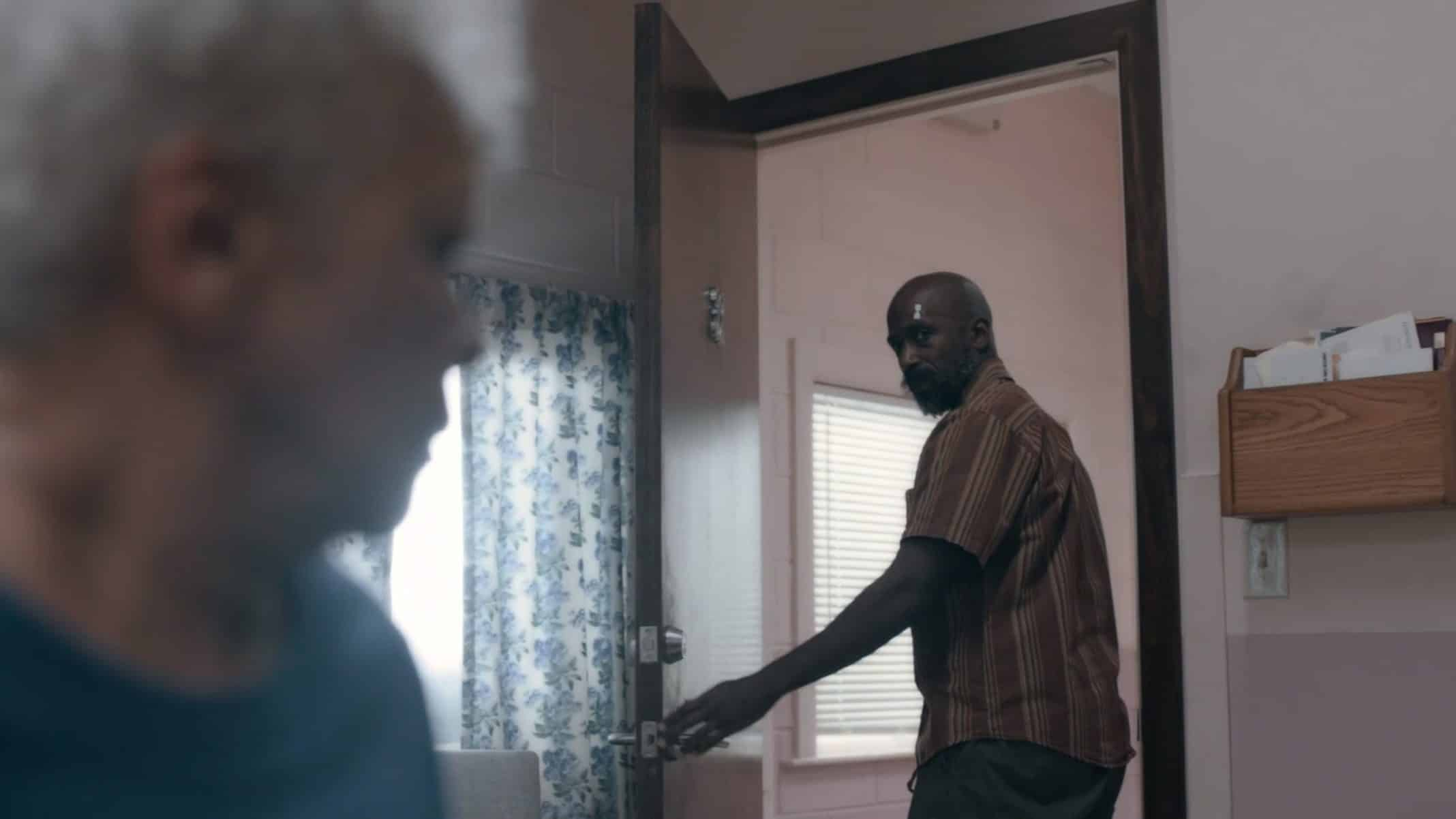 Ronnie (Ntare Guma Mbaho Mwine) leaving his grandmother's room, with hope he can become the hero she remembers.