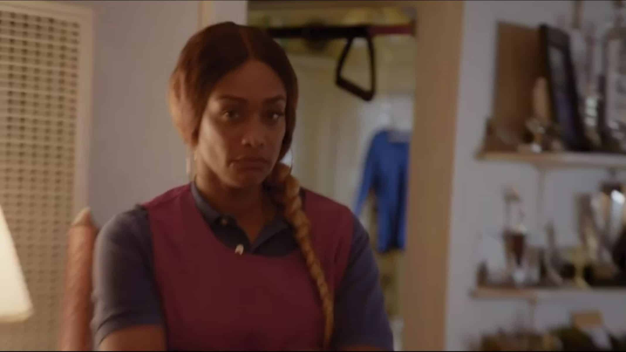 Sharea (Tami Roman) making it clear she don't like the camera focusing on her.