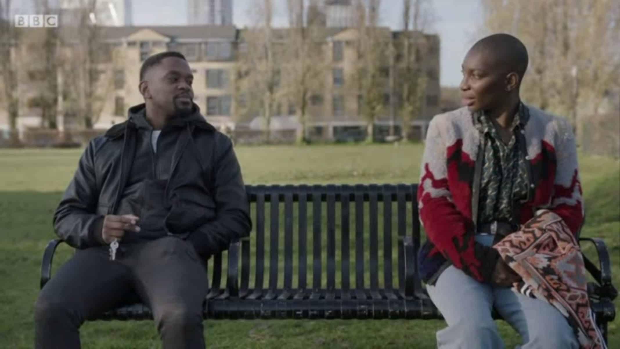 Simon (Aml Ameen) and Arabella (Michaela Coel) talking on a bench.