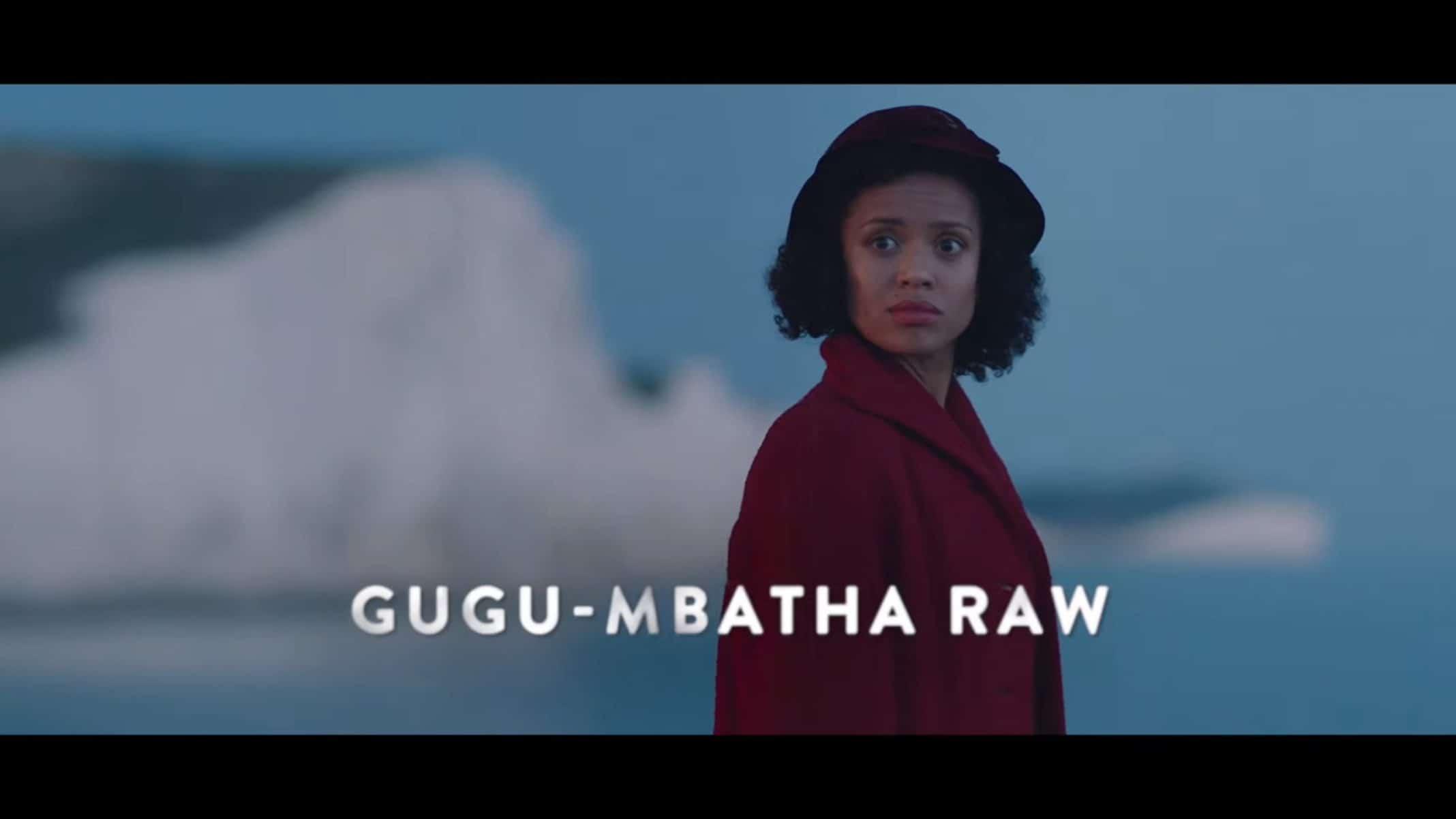 Vera (Gugu Mbatha-Raw) with a coastline behind her.