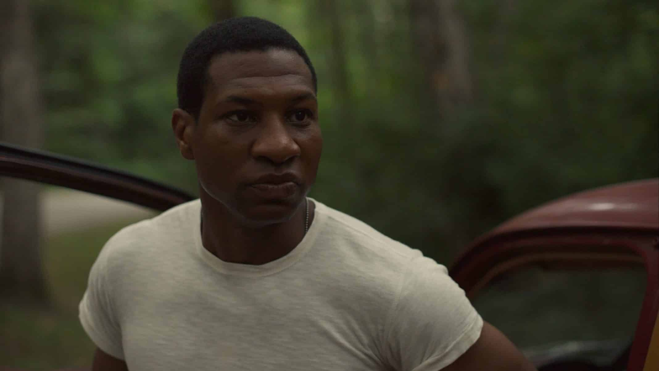 Atticus (Jonathan Majors) talking to a cop.