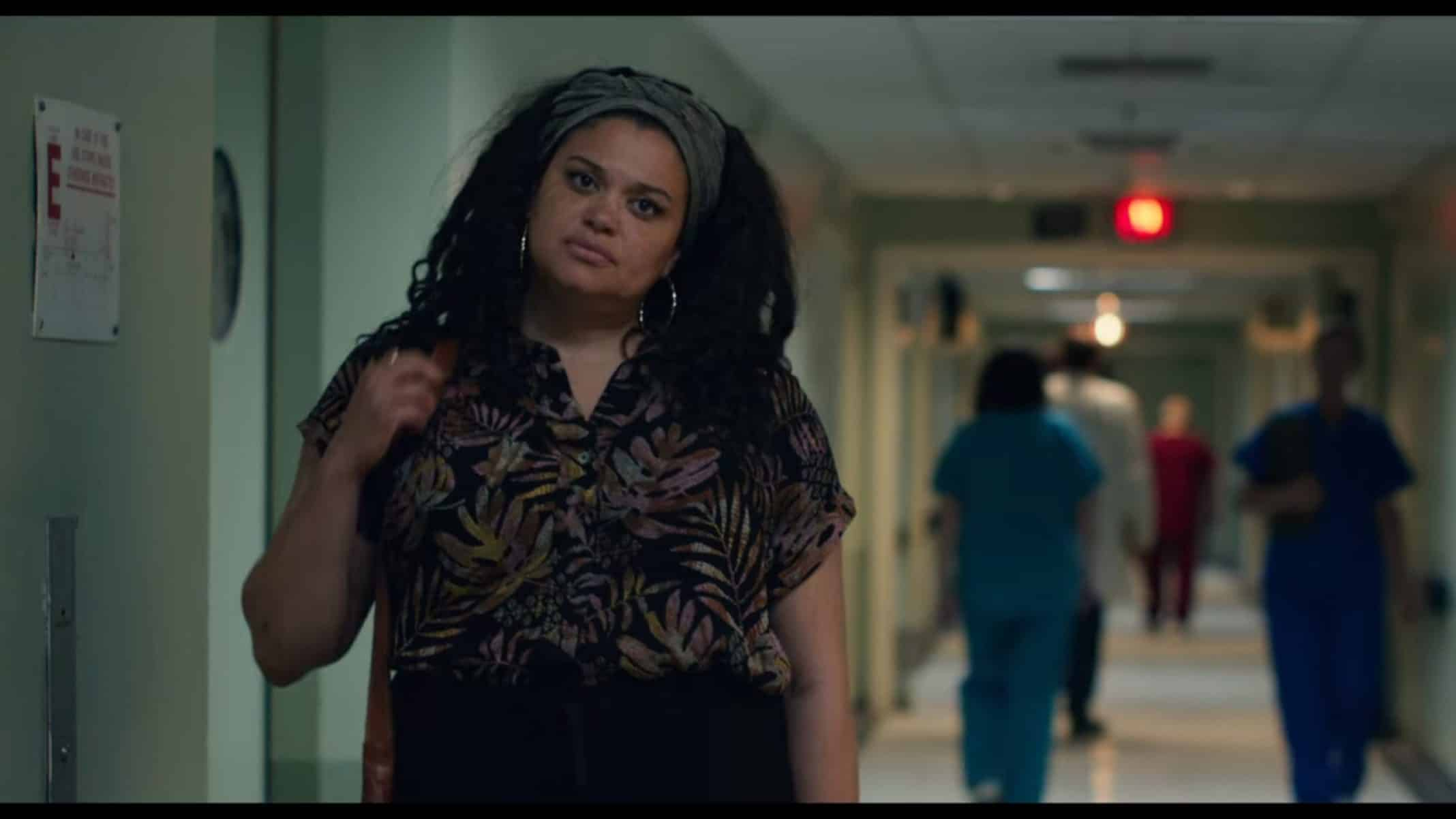 Cammy (Michelle Buteau) walking around in a hospital.