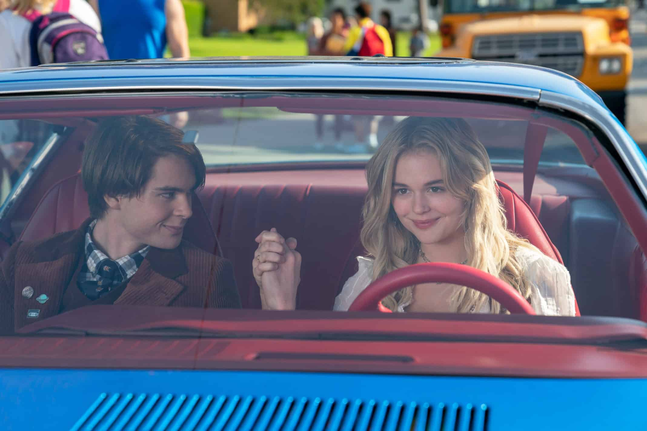 JUDAH LEWIS as COLE and EMILY ALYN LIND as MELANIE in Melanie's dad's car.