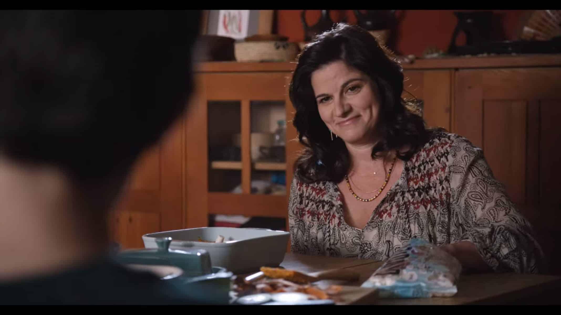 Mara (Lynn Adrianna) smiling at Elodie.