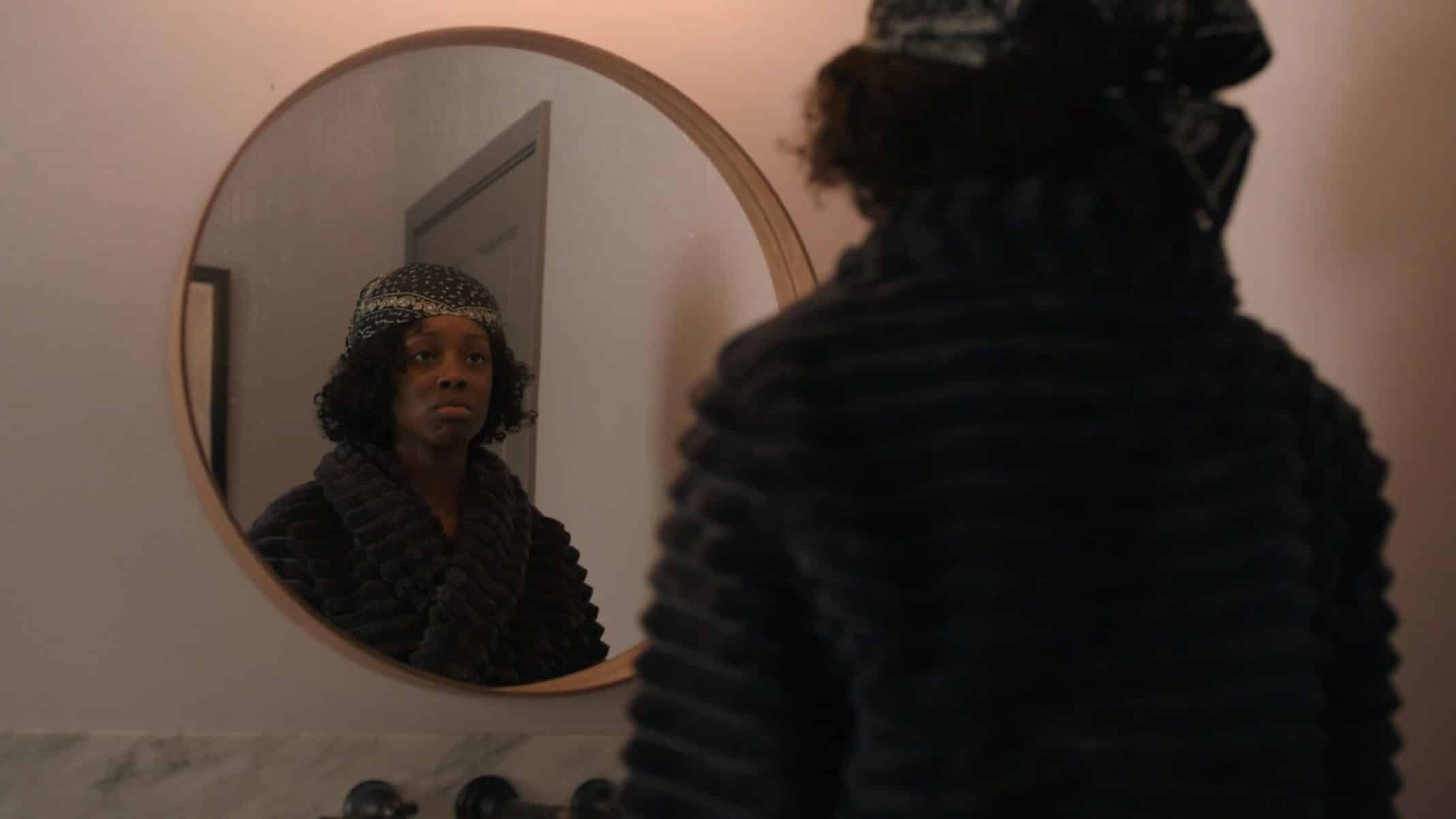 Kiesha looking into the mirror.