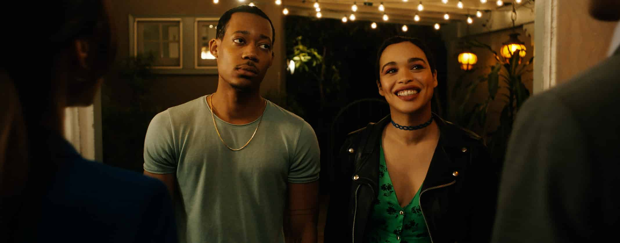 Paul (Tyler James Williams) seeming exasperated while Trina (Cleopatra Coleman) is excited.