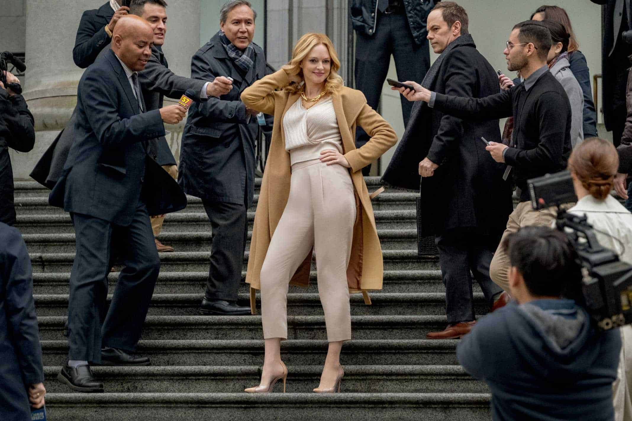 Tamara Taylor (Heather Graham) striking a pose on steps.