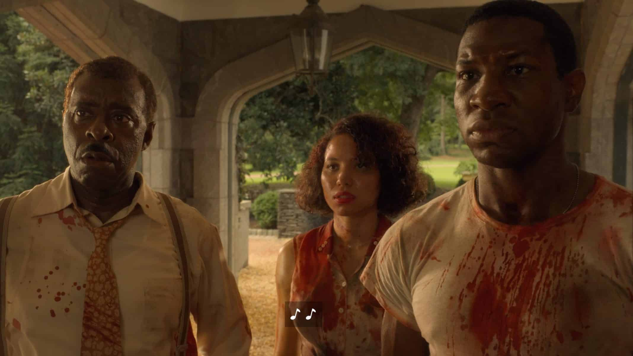 Uncle George (Courtney B. Vance), Letitia (Jurnee Smollett), and Atticus (Jonathan Majors) with blood on their clothes.