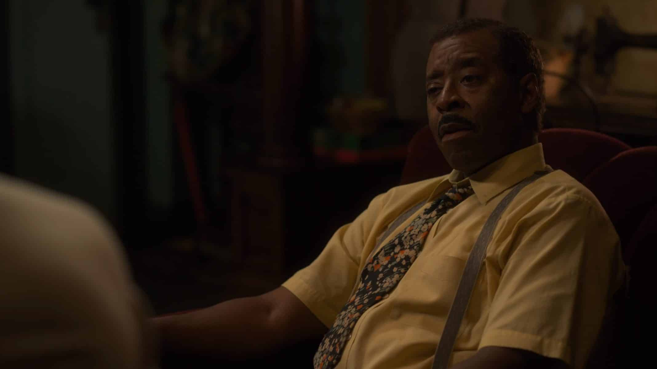 Uncle George (Courtney B. Vance) sitting back, looking mildly surprised.