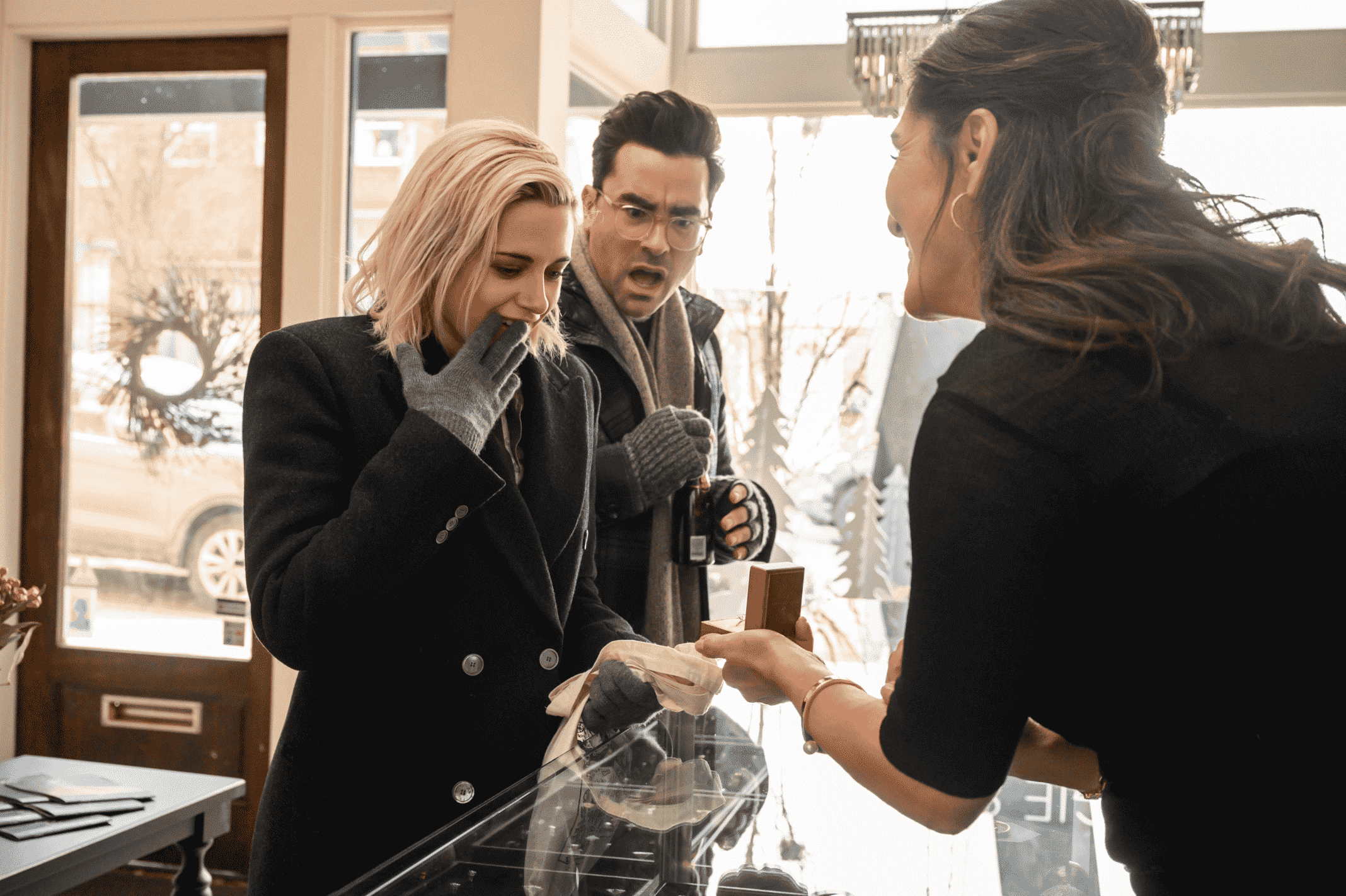 The Jeweler (SARAB KAMOO) shows Abby (KRISTEN STEWART) rings with John (DAN LEVY)