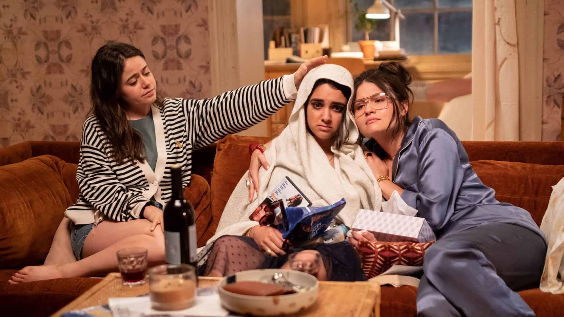 Amanda (Molly Gordon) and Nadine (Phillipa Soo) try to help Lucy (Geraldine Viswanathan, center) feel better