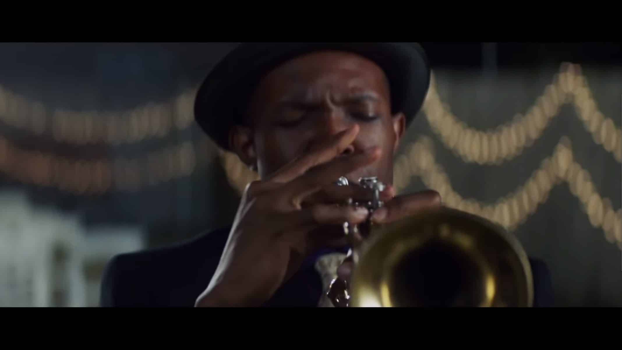 Andre (Denzel Whitaker) playing his trumpet.