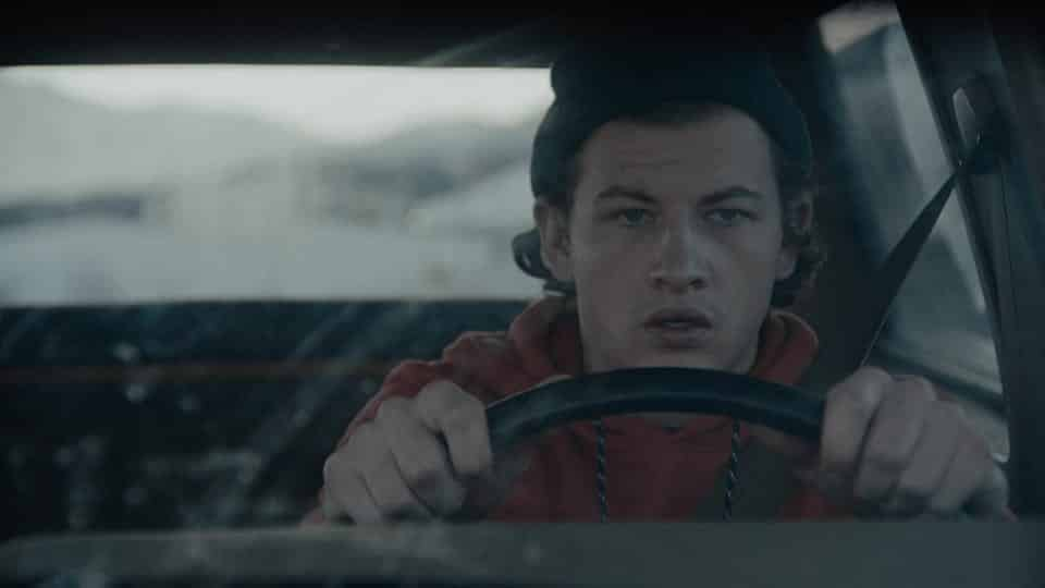 Andy (Tye Sheridan) driving a car.