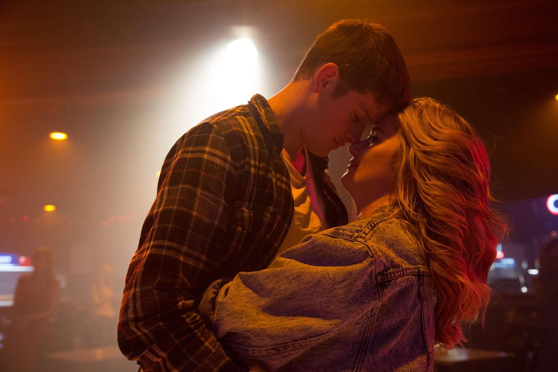 Brandon (Alex MacNicoll) and Pearla (Addison Timlin) dancing in a bar.