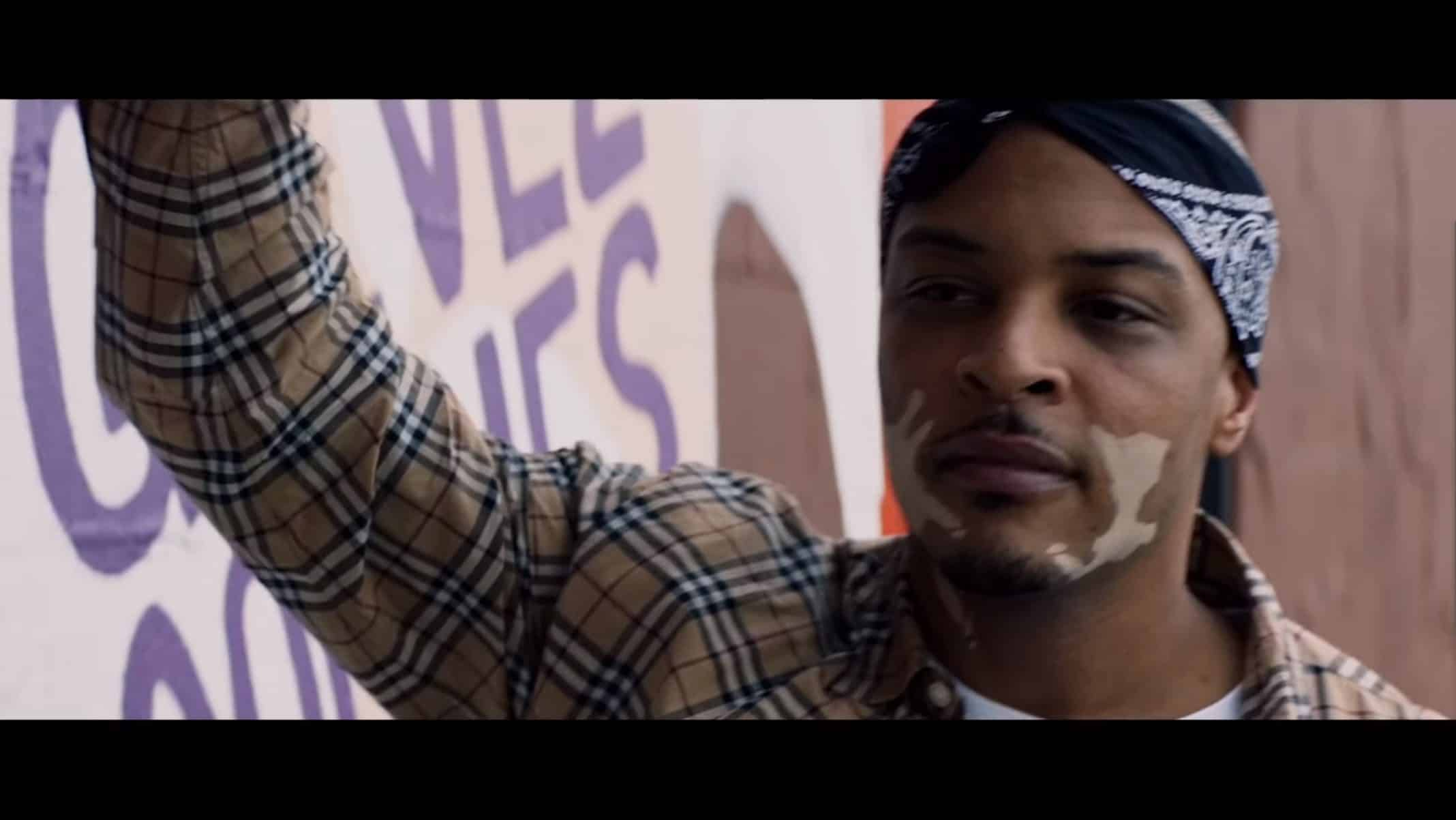 'Cousin' Bass (T.I.) talking to someone.