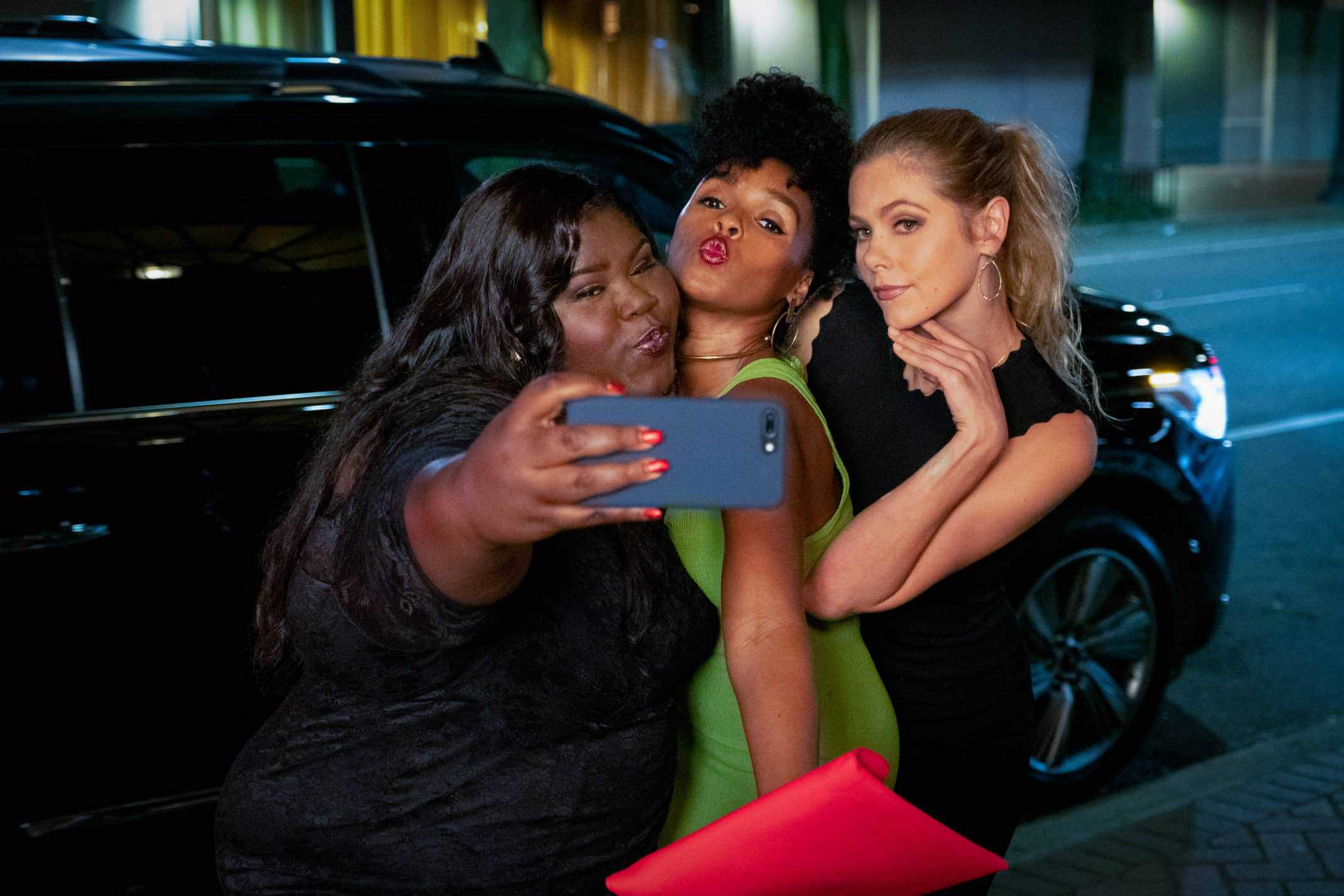 Dawn (Gabourey Sidibe), Veronica (Janelle Monae) and Sarah (Lily Cowles) taking a picture together.