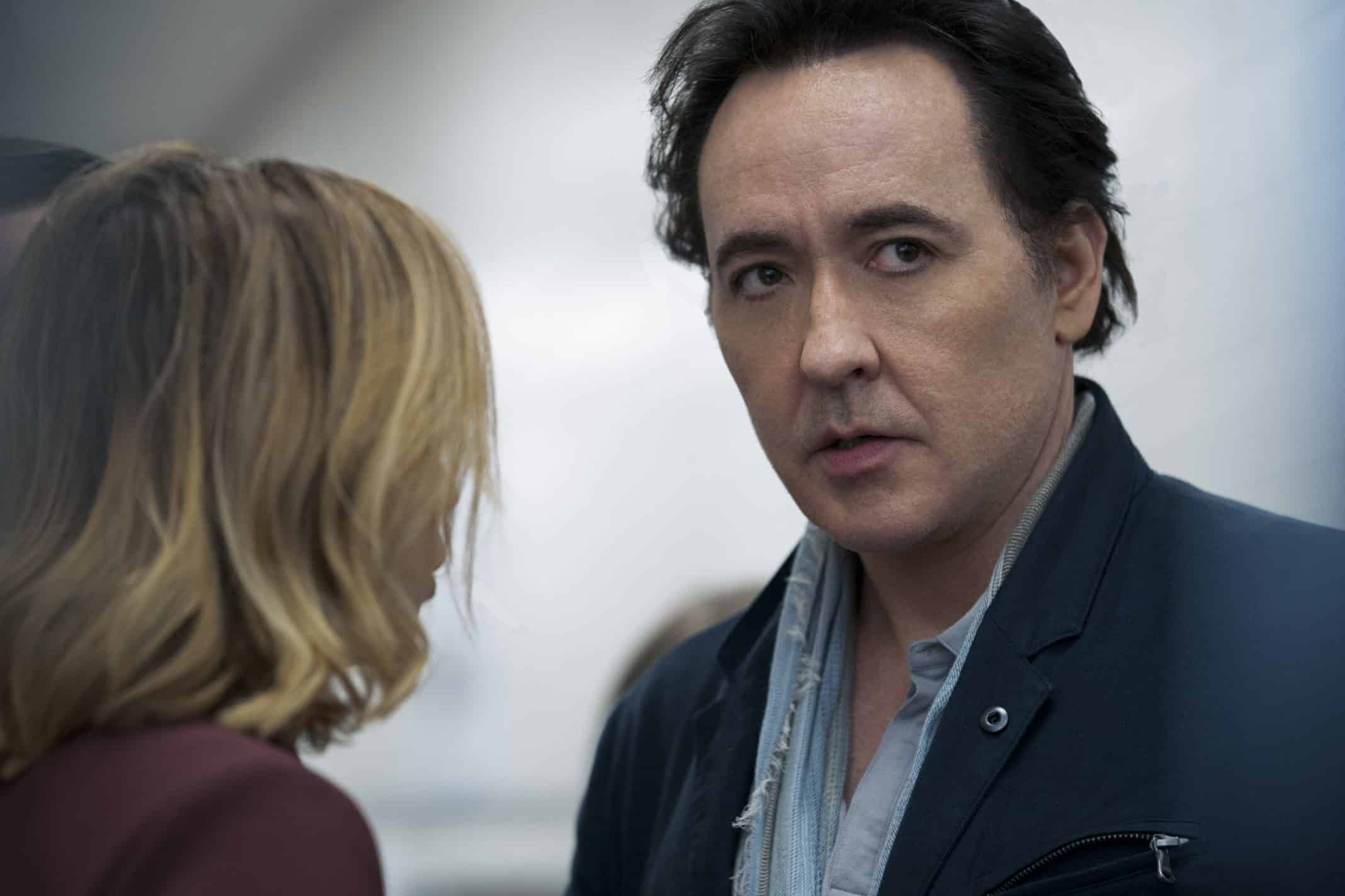 Dr. Kevin Christie (John Cusack) talking to someone.